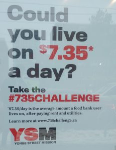 """The storefront of Double Take thrift shop displaying the phrase """"Could you live on $7.35 a day?"""" boldly in the front window.on Wednesday Feb. 6, 2019. Kyle Craib/RSJ"""