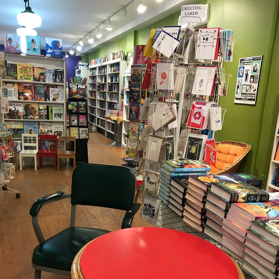 Sitting area in the bookshop featuring a small table and two chairs.