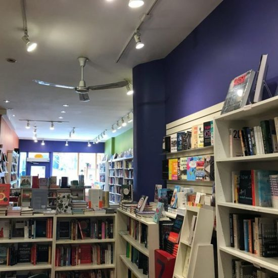 View of bookshelves from centre of the bookshop.