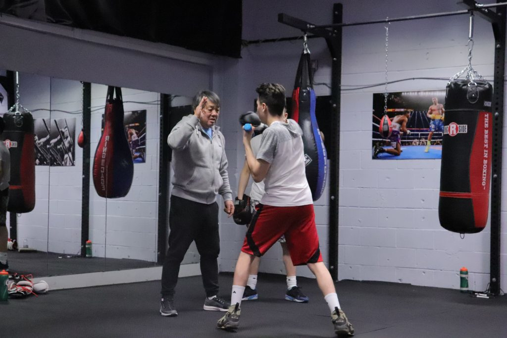 Kim showing Anthony punch technique