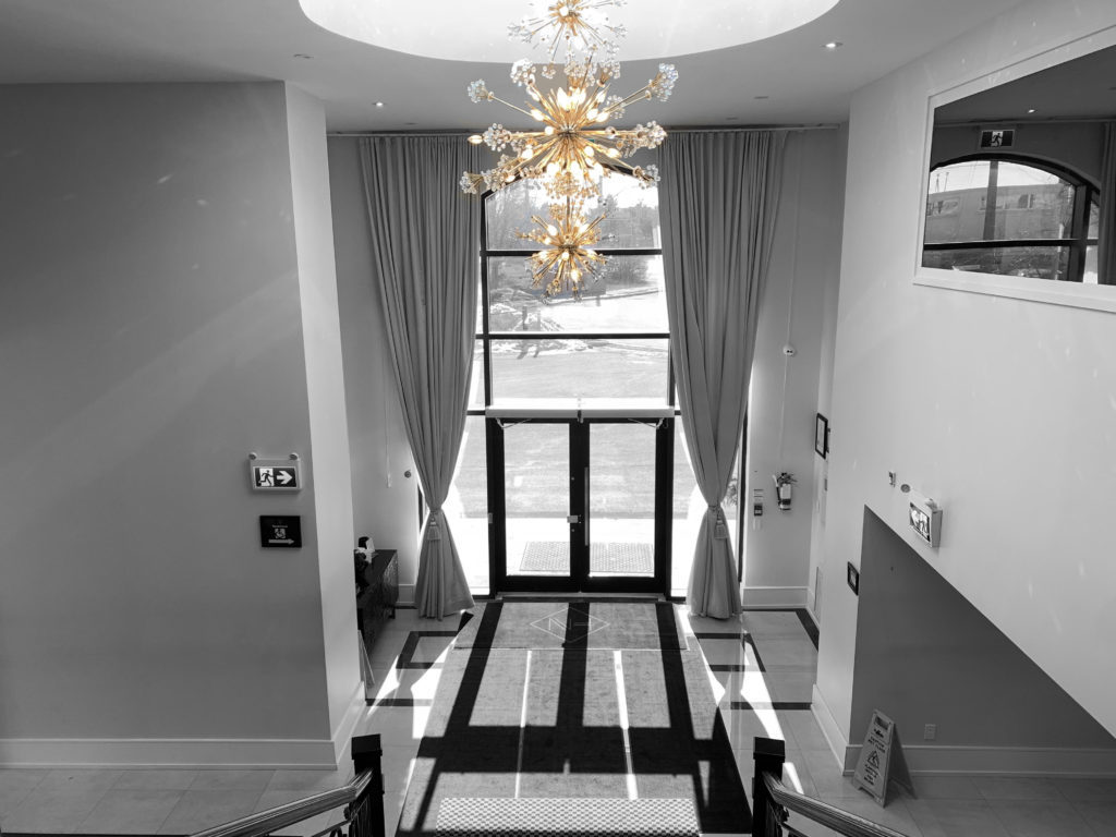 Chandelier hangs over the staircase at the entrance of the centre
