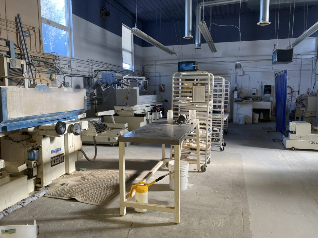A spacious factory space with white equipment.