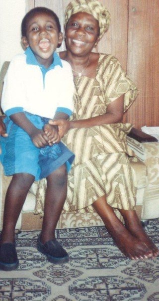 A  young boy sitting next to an older woman.