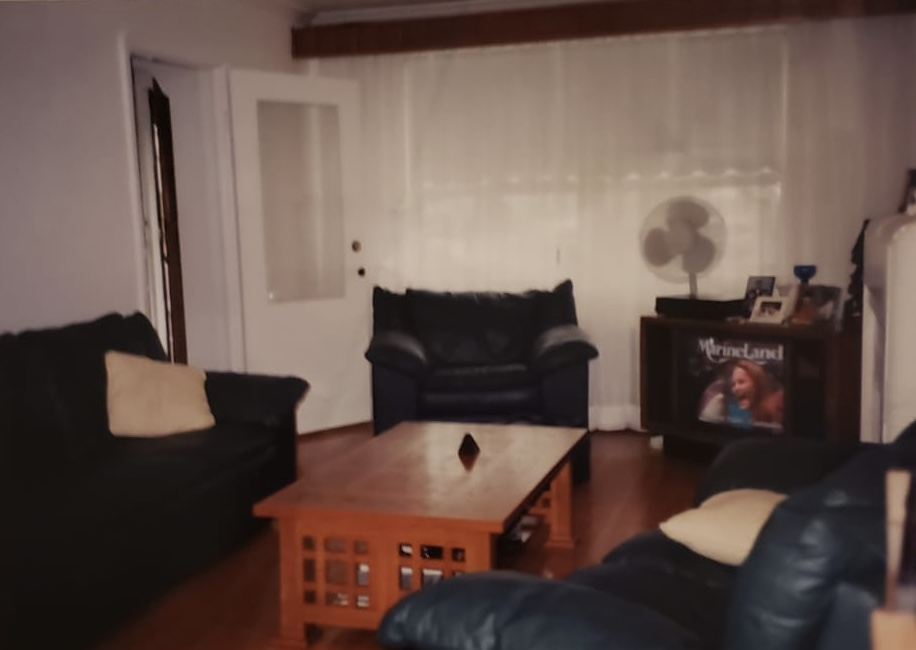 Family room set-up with couches, center table and television