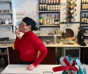 A staff member in a red sweater ordering a meal from the restaurant's kitchen.